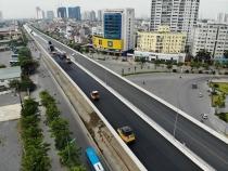 Đường vành đai 3 trên cao bắt đầu thảm nhựa, thay đổi bộ mặt đường Phạm Văn Đồng